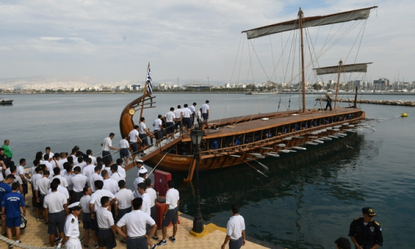 Cadets of the Hellenic and Argentinian Naval Academy row together aboard Trireme Olympias